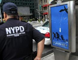 Essam placed dozens on posters like these throughout Manhattan.